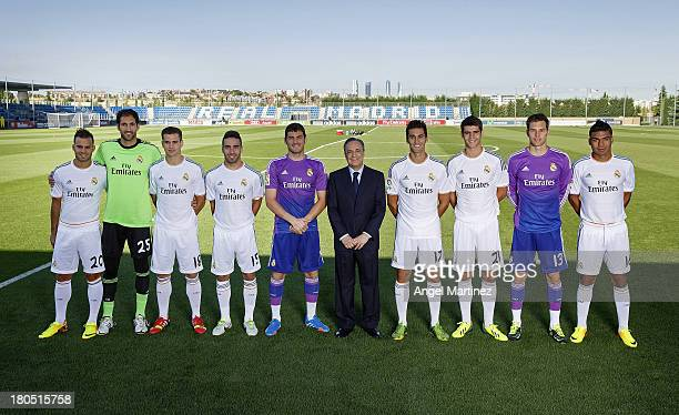 Real Madrid's President Florentino Perez poses with the club's homegrown players Jese Rodriguez Diego Lopez Nacho Fernandez Daniel Carvajal Iker...