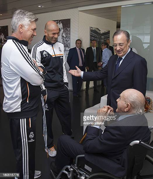 Real Madrid's President Florentino Perez talks with head coach Carlos Ancelotti assistant Zinedine Zidane and Honorary President Alfredo di Stefano...
