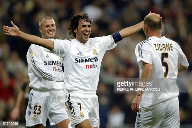 Real Madrid's Raul celebrates his goal against Albacete with teammates French Zinedine Zidane and Briton David Beckham during their Premier League...