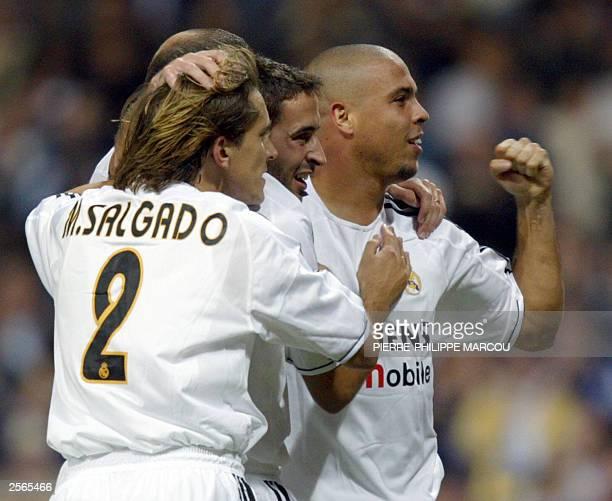 Real Madrid's Raul celebrates Ronaldo's goal against Espanyol with teammates Ronaldo and Michel Salgado during a Premier League match in Santiago...