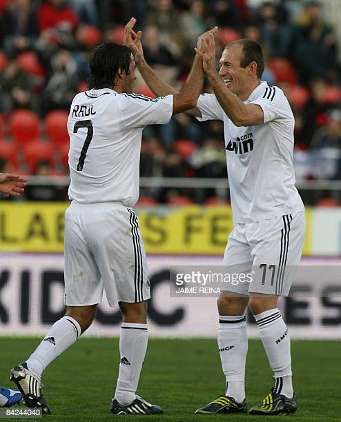 Real Madrid's Raul Gonzalez and teammate Dutch Arjen Robben celebrate after scoring against Mallorca during their Spanish Premier League football...