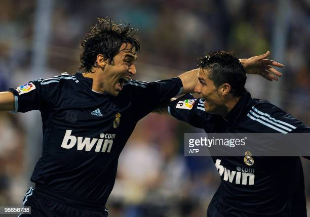 Real Madrid's Raul Gonzalez celebrates his goal with teammate Portuguese forward Cristiano Ronaldo against Zaragoza during their Spanish League...