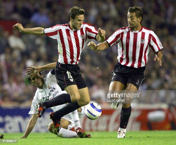 Real Madrid's Raul Gonzalez vies with Athletic's Carlos Gurpegui and Ismaem Urzaiz in a Spanish League match at the San Mames stadium in Bilbao 25...