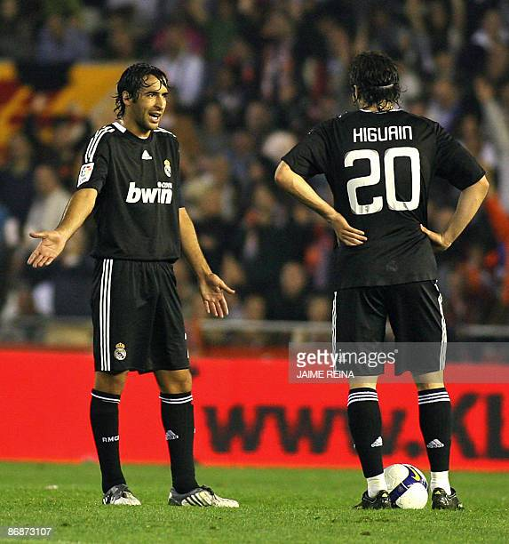 Real Madrid's Raul reacts next to teammate Argentinian Higuain after Valencia FC scored during their Spanish league football match at Mestalla...
