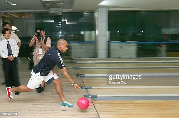 Real Madrid's Roberto Carlos plays bowling at the hotel after the Real Madrid team arrived on July 20 2005 in Xianghe county southeast of Beijing...