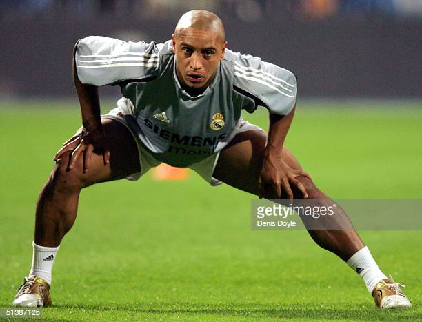 Real Madrids Roberto Carlos stretches prior to the Primera Liga match between Real Madrid and Deportivo La Coruna at The Bernabeu on October 3 2004...