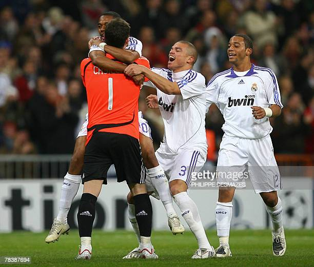Real Madrid's Robinho celebrates with goalkeeper Iker Casillas , Pepe and Marcelo after scoring against Lazio during their Champions League Group C...