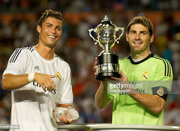 Real Madrid's Ronaldo and Iker Casillas hold their trophy after winning the 2013 International Champions Cup match between Real Madrid and Chelsea on...