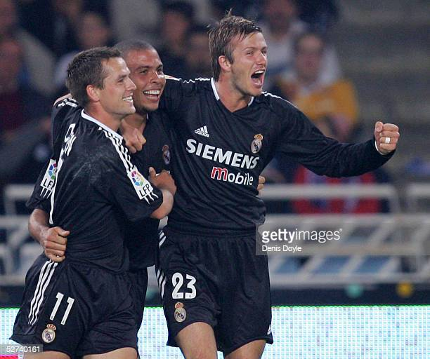 Real Madrid's Ronaldo celebrates scoring a goal with David Beckham and Michael Owen during a La Liga match between Real Sociedad and Real Madrid at...