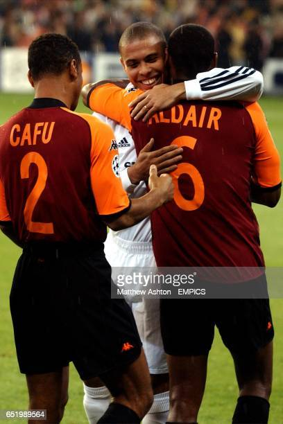 Real Madrid's Ronaldo greets his fellow Brazilians AS Roma's Cafu and Aldair