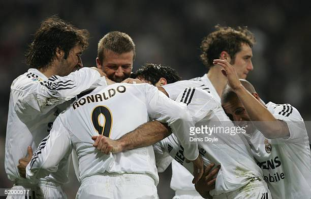 Real Madrid's Ronaldo is congratulated by teammates after scoring a goal during a Primera Liga soccer match between Real Madrid and Zaragoza at the...