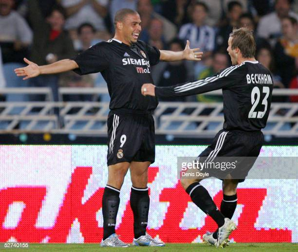 Real Madrid's Ronaldo Luiz Nazario de Lima celebrates scoring a goal with David Beckham during a La Liga match between Real Sociedad and Real Madrid...