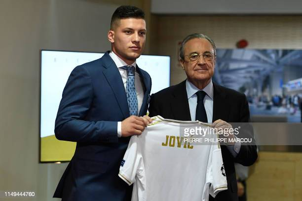 Real Madrid's Serbian forward Luka Jovic poses with Real Madrid's president Florentino Perez at the Santiago Bernabeu stadium in Madrid on June 12...