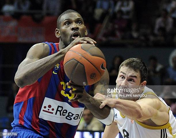 Real Madrid's Serbian Marko Jaric vies with Regal Barcelona's US Pete Mickeal during their third quarterfinal Euroleague basket ball match in Madrid,...