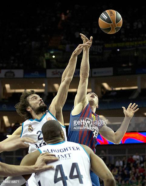 Real Madrid's Sergio Llull jumps for the ball against Barcelona's Marcelinho Huertas during their Euroleague 2013 Final Four basketball game at the...