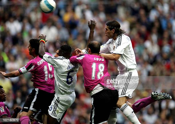 Real Madrid's Sergio Ramos and Malian Malian Mahamadou Diarra jump for a header with Deportivo la Coruña's Lopo and Capdevila during their Spanish...