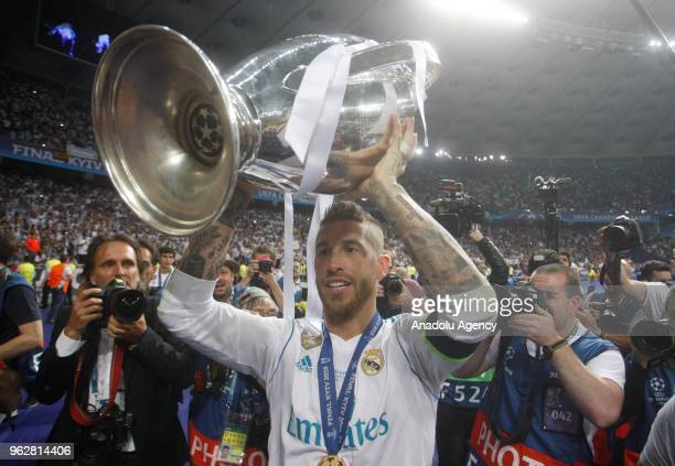 Real Madrid's Sergio Ramos raises the trophy after winning the UEFA Champions League final football match against Liverpool FC at the Olimpiyskiy...