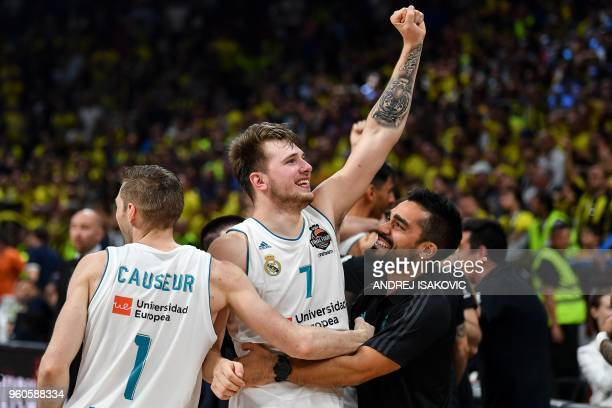 TOPSHOT Real Madrid's Slovenian Luka Doncic celebrates with team mate Real Madrid's French forward Fabien Causeur their team's 8580 win in the...
