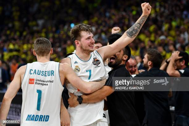 Real Madrid's Slovenian Luka Doncic celebrates with team mate Real Madrid's French forward Fabien Causeur their team's 8580 win in the Euroleague...