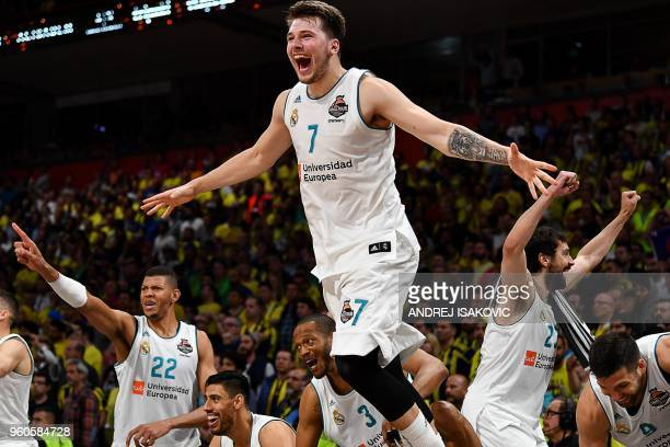 TOPSHOT Real Madrid's Slovenian Luka Doncic jumps over the barrier as the team celebrates their 8580 win in the Euroleague Final Four finals...