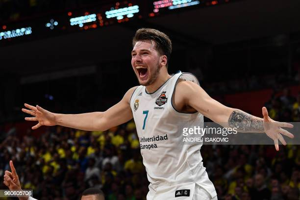 Real Madrid's Slovenian Luka Doncic jumps over the barrier as the team celebrates their 8580 win over Fenerbahce in the Euroleague Final Four finals...