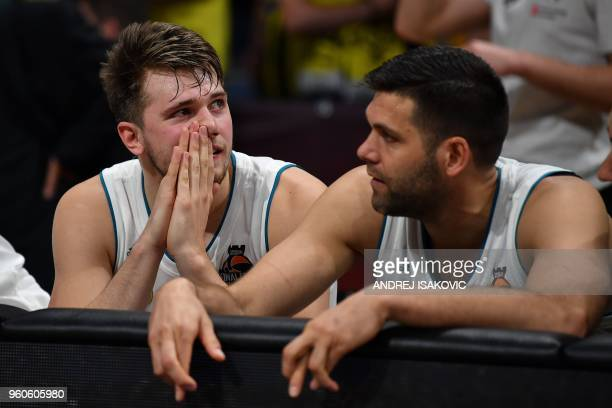 Real Madrid's Slovenian Luka Doncic looks on as a team mate keeps his fingers crossed during the final seconds of in the Euroleague Final Four finals...