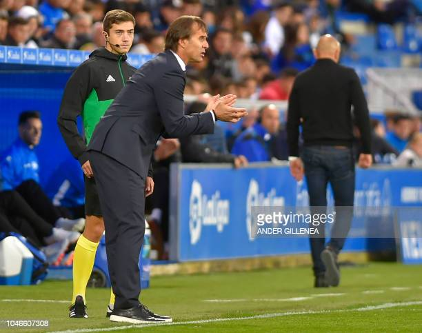 Real Madrid's Spanish coach Julen Lopetegui applauds from the sideline during the Spanish league football match between Deportivo Alaves and Real...
