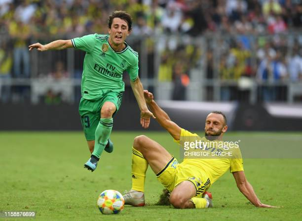 Real Madrid's Spanish defender Alvaro Odriozola and Fenerbahce's Kosovan striker Vedat Muriqi vie for the ball during the Audi Cup football match for...