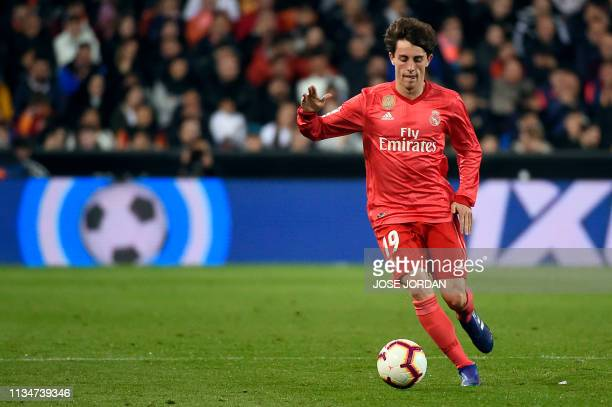 Real Madrid's Spanish defender Alvaro Odriozola dribbles the ball during the Spanish league football match between Valencia CF and Real Madrid CF at...
