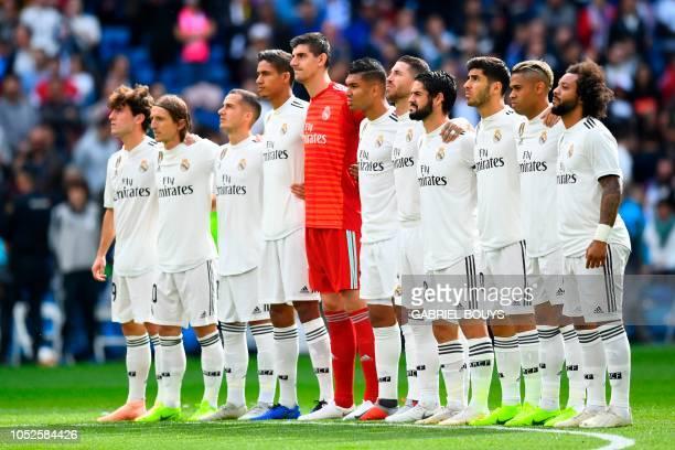 Real Madrid's Spanish defender Alvaro Odriozola Real Madrid's Croatian midfielder Luka Modric Real Madrid's Spanish midfielder Lucas Vazquez Real...