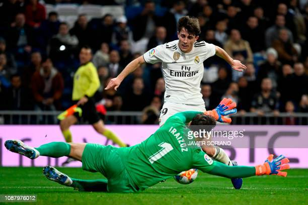 Real Madrid's Spanish defender Alvaro Odriozola vies for the ball with Girona's Spanish goalkeeper Gorka Iraizoz during the Spanish Copa del Rey...