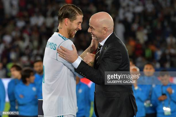 Real Madrid's Spanish defender and captain Sergio Ramos is congratulated by FIFA President Gianni Infantino following the Club World Cup final...