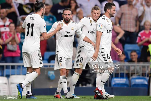 Real Madrid's Spanish defender Dani Carvajal celebrates with teammates after scoring a goal during the Spanish League football match between Real...