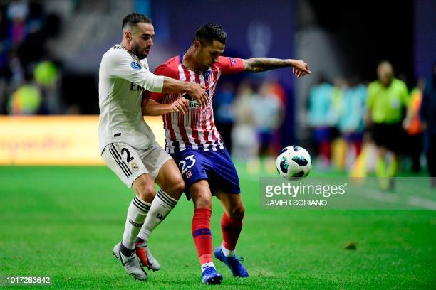 Real Madrid's Spanish defender Dani Carvajal challenges Atletico Madrid's Spanish forward Vitolo during the UEFA Super Cup football match between...
