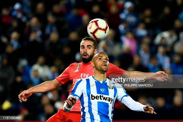 Real Madrid's Spanish defender Dani Carvajal challenges Leganes' Danish forward Martin Braithwaite during the Spanish league football match between...