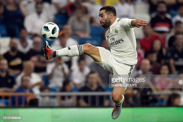 Real Madrid's Spanish defender Dani Carvajal controls the ball during the Santiago Bernabeu Trophy football match between Real Madrid and AC Milan in...