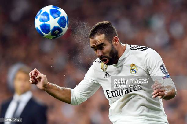Real Madrid's Spanish defender Dani Carvajal heads the ball during the UEFA Champions League group G football match between Real Madrid CF and AS...