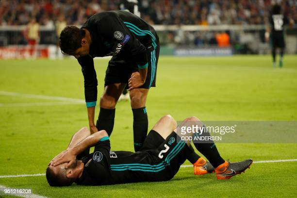 Real Madrid's Spanish defender Dani Carvajal lays injured during the UEFA Champions League semifinal firstleg football match FC Bayern Munich v Real...
