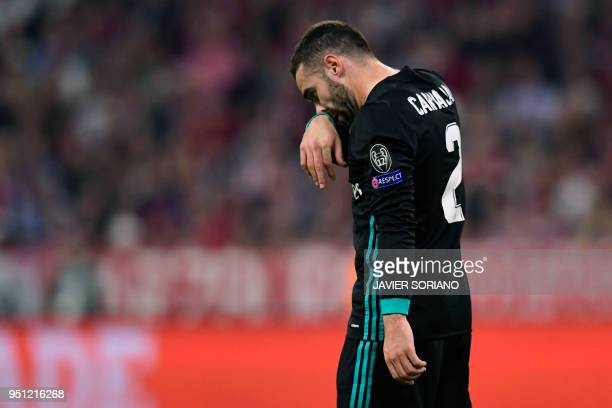 Real Madrid's Spanish defender Dani Carvajal leaves the field during the UEFA Champions League semifinal firstleg football match FC Bayern Munich v...