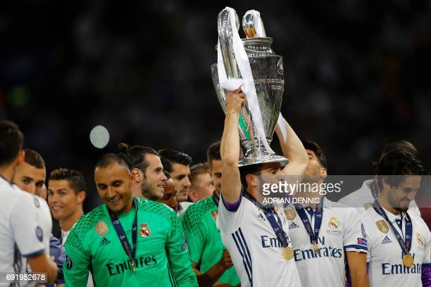 Real Madrid's Spanish defender Dani Carvajal lifts the trophy after Real Madrid won the UEFA Champions League final football match between Juventus...