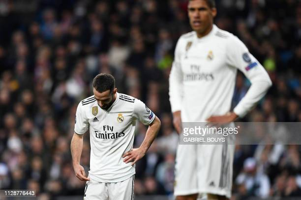 Real Madrid's Spanish defender Dani Carvajal reacts during the UEFA Champions League round of 16 second leg football match between Real Madrid CF and...