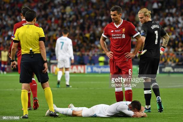 Real Madrid's Spanish defender Dani Carvajal reacts on the ground during the UEFA Champions League final football match between Liverpool and Real...