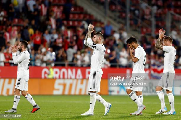 Real Madrid's Spanish defender Dani Carvajal Real Madrid's Spanish defender Sergio Ramos Real Madrid's Spanish midfielder Marco Asensio and Real...