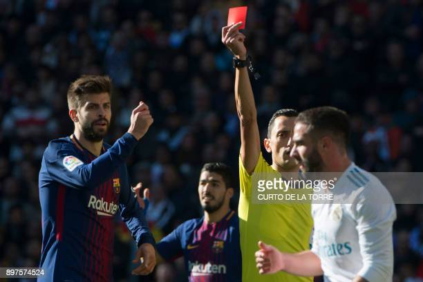 Real Madrid's Spanish defender Dani Carvajal receives a red card during the Spanish League 'Clasico' football match Real Madrid CF vs FC Barcelona at...