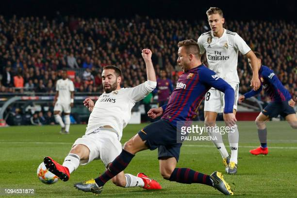 Real Madrid's Spanish defender Dani Carvajal vies for the ball with Barcelona's Brazilian midfielder Arthur during the Spanish Copa del Rey semifinal...