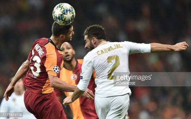 Real Madrid's Spanish defender Dani Carvajal vies for the ball with Galatasaray's Romanian forward Florin Andone during the UEFA Champions League...