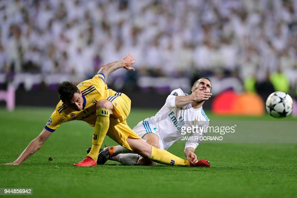 Real Madrid's Spanish defender Dani Carvajal vies with Juventus' Croatian forward Mario Mandzukic during the UEFA Champions League quarterfinal...