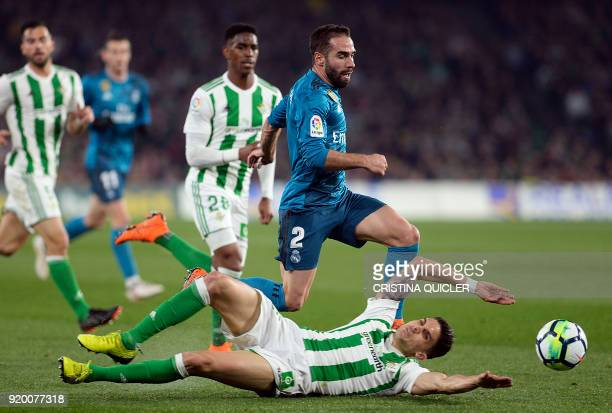 Real Madrid's Spanish defender Dani Carvajal vies with Real Betis' Spanish defender Marc Bartra during the Spanish Liga football match Real Betis vs...