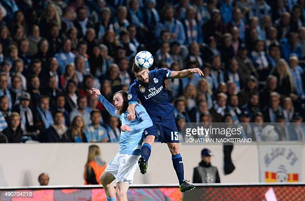 Real Madrid's Spanish defender Daniel Carvajal and Malmo's Norwegian midfielder Jo Inge Berget vie for the ball during the UEFA Champions League...