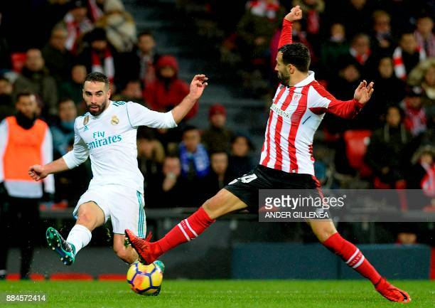 Real Madrid's Spanish defender Daniel Carvajal challenges Athletic Bilbao's Spanish defender Mikel Balenciaga during the Spanish league football...